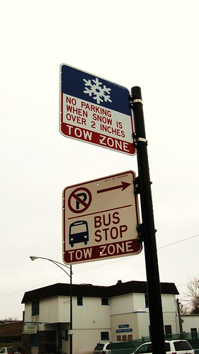 Bus Stop and No Parking snow removal signs on Northwest Highway. Chicago Illinois. January 2010.
