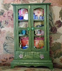 Enchanted Elegant Collection Display Cabinet ~ 1:12 Scale (Enchanticals~ Death in Family) Tags: wood pink wallpaper green glass car metal lady silver sadness gold mementos miniature bottles cabinet furniture handmade joy memories happiness convertible collection polkadots cups jackinthebox passion ribbon amethyst collectible figurine homedecor possessions collectibles collecting treasures dollhouse dioramas roadster crystalball littlethings trinketbox perfumebottles 112scale roomboxes 112thscale dollhouseminiature onetwelfthscale ladystatue etsyartists etsyteams minimakers miniaturedoors damteam scaledollhouseminiature teammids enchanticals miniaturedollhousescale minitreasures scaleoneinch handcraftedminiatures enchanticalsetsy miniaturesindollhousescale scaleonetwelfth miniaturecollector 112scaledollhousescale