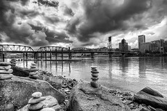 Stacks of Balanced Rocks - HDR (David Gn Photography) Tags: city skyline clouds oregon portland landscape rocks downtown waterfront skyscrapers stones bridges stormy zen hawthornebridge willametteriver hdr rockstacking rockbalancing eastbankesplanade canoneos7d sigma1020mmf35exdchsm