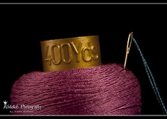400 Yards... (Abdallah | Photography) Tags: blue yards black macro thread canon photography eos rebel 50mm amazing interesting purple 10 top teal extreme explore needle 25 400 com roll ef f25 compact xsi abdallah 450d canonef50mmf25compactmacro 400yds
