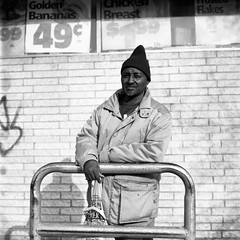 (m. wriston) Tags: city winter portrait people urban usa white signs man black brick 6x6 tlr film face hat wall analog america point store coat united broadway maryland baltimore mat fells 124g diafine don 100 states analogue grocery edu folks ultra yashica pushprocessed selfdeveloped arista