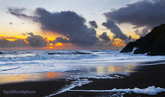 Black Sand - Rodeo Beach, California (Darvin Atkeson) Tags: ocean california travel sunset vacation usa sun reflection art beach america photography golden us gate surf pacific artistic area beaches rodeo recreation   potofgold  darvin atkeson  darv   liquidmoonlightcom