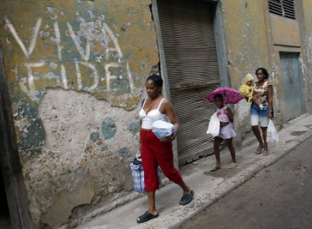 Cubans begin evacuating from their homes Sunday, Sept. 12, 2004 in Havana, Cuba before Hurricane Ivan's arrival. About half a million of people are being evacuated to shelters as they expect Ivan to hit western Cuba between Sunday night and Monday morning
