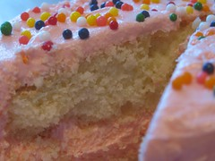 Inside a Yellow Cake with Pink Buttercream Frosting and Rainbow Sprinkles (PinkCupcake) Tags: birthday cake dessert sprinkles snack frosting
