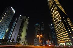 The Revolution of Skyscrapers (Bo AhmaD) Tags: night wideangle doha qatar skyscapers canonefs1022mm boahmad navigationtower tornadotower alfardantower