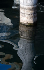 Dock Piling Reflections (Marilyn Dunstan Photography) Tags: seattle reflection water reflections flow us washington dock patterns tranquility fluid zen serenity designs serene ripples rippled piling wavy tranquil patience fluidity dockpiling