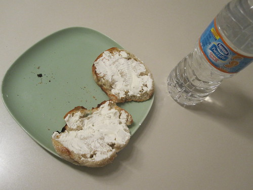 English muffin with cream cheese and orange water