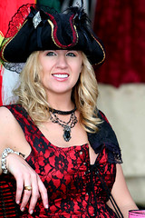 Beautiful Blonde Pirate Wench (wyojones) Tags: woman girl beautiful beauty smile hat festival hair skulls necklace eyes pretty texas lace teeth greeneyes pirate blonde bracelet corset faire curl renfaire lovely renaissancefestival merchant renaissance renaissancefaire renfest wench rennie shopgirl piratehat texasrenfest texasrenaissancefestival plantersville toddmission wyojones shopwench
