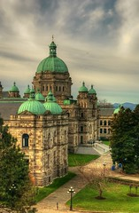 The British Columbia Legislature or Parliament (Brandon Godfrey) Tags: world pictures above trees windows roof sky building fountain grass architecture clouds stairs buildings landscape photography photo scenery bc photos pics earth britishcolumbia sony details capital lawn parliament scene victoria flags canadian vancouverisland dome creativecommons copper pacificnorthwest northamerica olympic alpha dslr domes legislature hdr highdynamicrange jamesbay 2010 capitals a300 photomatix tonemapped tonemapping sonya300