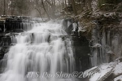 Silkiy flowing water fall (smootlee) Tags: snow icecycles flowingwater manchestertn rutledgefalls 2010winterscene