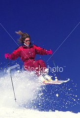 Young woman in red one-piece ski suit downhill skiing (nigel67) Tags: winter vacation portrait woman mountain snow girl smile sunglasses happy clothing pretty adult time expression teens lifestyle teen leisure skis youngwoman jumpsuit teenage 20s skigoggles skipoles skiwear teenagegirl