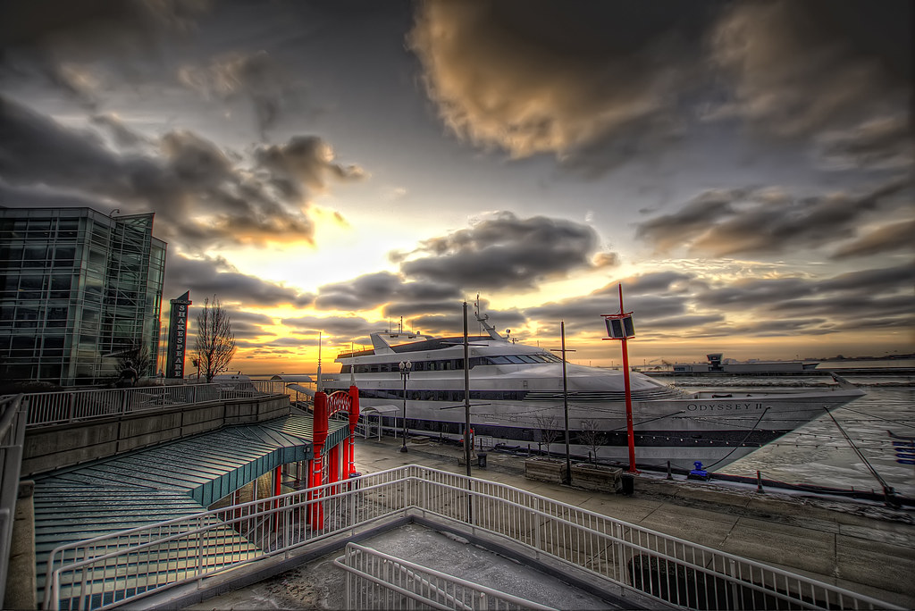 A boat at Navy Pier during a sunrise.
