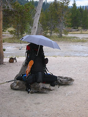 At some point I wheeled around to discover that Tim had used his umbrella to protect his pack from geyser mist.  Another innovative use for off-the-street technology.
