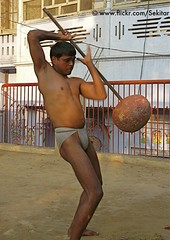 Kushti Wrestler swinging a gada at Tulsi Ghat Akhara, Varanasi (Sekitar) Tags: shirtless india man male wrestling indian varanasi hanuman strong wrestler mace swinging tulsi pradesh benares ghat uttar uttarpradesh gada akhara sekitar kusthi gymnasia kushti kusti earthasia pehlwani pehlawi sekitar