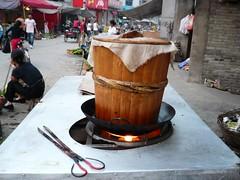 Rice Cooker - Rongjiang, Guizhou, China (John Meckley) Tags: china travel food asian cuisine bucket asia rice chinesefood chinese steam  tongs guizhou cooker zhongguo liping rongjiang ricebucket