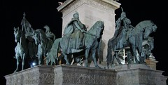 Heroes Square/Hsk tere at night 1 (Moldovia) Tags: city nightphotography travel horses history night square hungary anniversary events budapest group culture eu 7 landmark seven historical pointandshoot column tas magyar citycenter iconic figures sculptures hu citycentre europeanunion pointshoot tere easterneurope sculptor conquest historicalsite heroessquare tomboftheunknownsoldier magyars magyarorszg centraleurope travelphotography chieftains capitalcity hsktere imrenagy huba hsk millennialmonument ond kond millenniummonument nationalleaders ttny millenniummemorial andrssyavenue zalagyrgy rpd eld sonydscw300 carpathianbasin thtm millenriumiemlkm sevenchieftainsofthemagyars