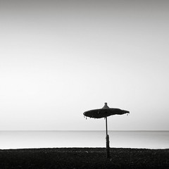 Parasol (Maria Stromvik) Tags: longexposure sea beach water strand seaside sand mediterranean cyprus parasol vatten hav larnaca seacape parasoll medelhavet cypern