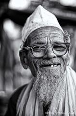 Old Man (Apratim Saha) Tags: old portrait people india white man black painting 50mm blackwhite nikon indian oldman nikond70s dailylife kolkata nationalgeographic saha northindia siliguri 14d blackwhitephotos mywinners apratim lifeinindia lifeculture apratimsaha