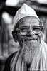 Old Man (Apratim Saha) Tags: old portrait people india white man black painting 50mm blackwhite nikon indian oldman nikond70s dailylife kolkata nationalgeographic saha northindia siliguri 14d blackwhitephotos mywinners apratim lifeinindia lifeculture apratimsaha