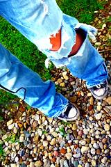 (shootingstarrs) Tags: green feet girl grass shoes rocks ipod pants legs tan holes jeans teen converse teenager chucks hollister
