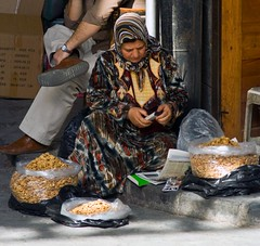 woman and walnuts, damascus souk