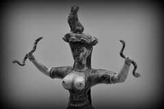 Goddess with a cat on her head holding two snakes (trvbaker) Tags: sculpture stone museum cat greek ancient breasts nipples goddess creta crete sacred classical quaint snakes heraklion minoan diosa antiquity iraklion desse