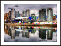 Vancouver Skyline (Clayton Perry Photoworks) Tags: city blue sky canada color colour water skyline vancouver clouds canon buildings reflections spring downtown bc stadium britishcolumbia falsecreek inlet hdr gmplace concordpacific canonphotography van2010 1dmarkiii canon1dmarkiii canadahockeyplace
