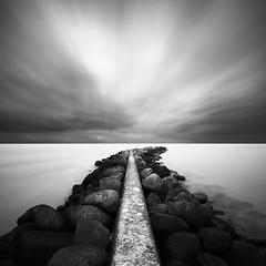 Deflection (Maria Stromvik) Tags: longexposure sky cloud seascape rock concrete pier sweden harbour jetty horizon balticsea skanr waterscape ndfilter bwnd110