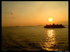 Sunset (Fernando X. Sanchez) Tags: nyc newyorkcity sunset summer newyork water ferry boat peace afternoon olympus calm fernando 2009 sanchez e500 fernandosanchez