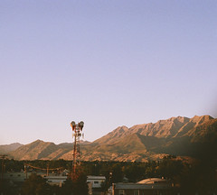 Radio (α RAINYNEPTUNUS ω) Tags: city sunset summer mountain mountains film analog utah analogphotography sunglow filmphotography