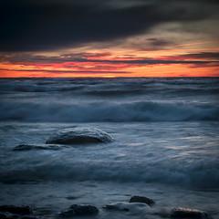 ~WaKe Up CaLL ~ (Chris Noronha) Tags: morning blue chris red sky sun lake seascape water rock clouds sunrise landscape photography nikon waves noronha