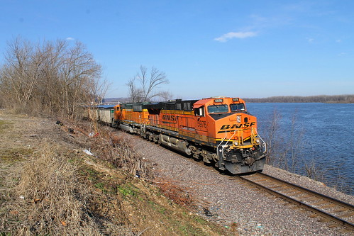 BNSF 5976 leads a coal next to the Mississippi river.