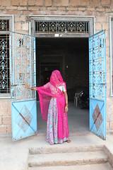 Standing by the door