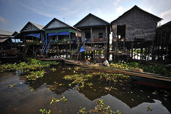 Tonle Sap Lake, Cambodia (Asian Development Bank) Tags: houses homes people vegetables rural boats asia cambodia locals transport lakes coastal canoes transportation rivers waters produce khm stilts citizens seas coasts tonlesap rowboats residences boatmen provinces boatwomen watertransports vision:mountain=0618 vision:sky=0762 vision:outdoor=0774 homesinstilts