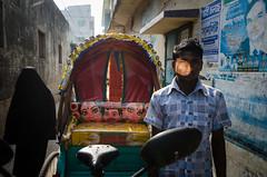 Sunlit (AvikBangalee) Tags: red woman sunlight man male female poster mirror veil bills hijab streetphotography lifestyle lane driver dhaka dailylife sunlit rickshaw niqab bangladesh socialdocumentary burkha olddhaka rickshawart purdah khimar rickshawpuller bodycover kamrangirchar rickshawpainting