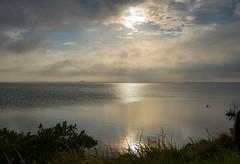 Evening on Merritt Island (Ruthie Kansas) Tags: sky sun reflection water clouds island merrittislandflorida