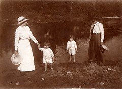 Paddling in the river, possibly the River Dee near Aboyne. (EastMarple1) Tags: summer woman water hat vintage river toddler child paddle