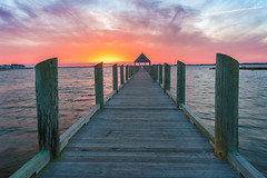 Ocean City Dreaming (Xavier Ascanio) Tags: md oceancity pier twilight winter bay boardwalk clouds colorful dusk magenta orange pink reflection sky sound sunset vacation water weather yellow