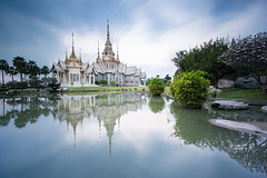 Beautiful Thai Temple (Wat Non Kum) and Reflection (baddoguy) Tags: architecture awe buddhism buildingexterior chineseculture colorimage copyspace dramaticsky elegance famousplace goldcolored horizontal lake landscape landscaped locallandmark majestic nakhonratchasima nopeople outdoors palmtree peaktower photography placeofworship pond publicpark reflection religion ruralscene scenics spiked spire standingwater sunset symmetry templebuilding thaiculture thailand tourism tranquility travel traveldestinations tree twilight wat water watersurface