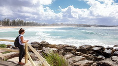 63+448: A moment's contemplation (geemuses) Tags: manly nsw australia manlybeach sea sand surf waves water ocean landscape scenic scenery rocks cliffs view clouds sun cliff nature northernbeaches natural autumn