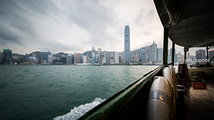 Sailing with the Star Ferry by the Hong Kong Bay, Hong Kong, SAR of China (monsieur I) Tags: asia abroad asian city cityscape faraway hongkong hongkongbay hongkongisland monsieuri panorama skyscrapers travel traveler urban water world laowa12mmf28zerod wideangle nodistorsion laowa