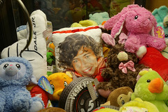 Claw Machine at Truck Stop 4-9-17 01 (anothertom) Tags: brooklyniowa truckstop diner clawmachine toyclawcrane contents prizes plushtoys harrystylespillow dalejr easterbunny duckie sonyrx100ii 2017
