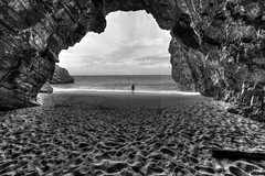 Caved in (Elios.k) Tags: horizontal outdoors people oneperson girl small wideangle cave interior inside rock opening sea background sky clouds cloudy weather water sand hdr highdynamicrange blackandwhite bw monochrome beach travel travelling september 2016 summer vacation canon 5dmkii camera photography milopotamos mylopotamos μυλοπόταμοσ πήλιο pelion greece ελλάδα thessaly aegeansea