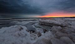 Frozen sea (Alec_Hickman) Tags: frozen sea ocean water ice snow winter canada rugged nature sunrise colors freeze cold sun clouds