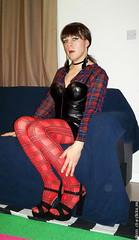 rock chic 4 (eileen_cd) Tags: leatherdress plaid featherearrings ponytail crossdresser transvestite cd tv