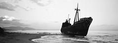 shipwreck (thodoris markou) Tags: analog 35mm film panoramic hasselbladxpan hasselblad xpan panorama sea ilford blackwhite 45mmf4 shipwreck beach pan 400
