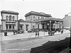 GNR [i.e. Great Northern Railway] Station, Belfast (National Library of Ireland on The Commons) Tags: robertfrench williamlawrence lawrencecollection lawrencephotographicstudio thelawrencephotographcollection glassnegative nationallibraryofireland greatnorthernrailwaystation belfast horses hackneys sidecars people ghosts ulster portecochère station gnr railwaystation greatnorthernrailway greatvictoriastreet