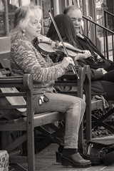 The Fiddler (vodophoto's images) Tags: woman old street monochrome sitting music fiddle vodophoto photography mirrorless olympus pa newhope