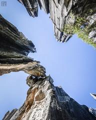 Shilin Rock Wall (lycheng99) Tags: rocks rockformation rock shilin yunnan china travel shilinstoneforest stoneforest dangerous danglingrock sky top tall panorama