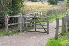 The Gateway (M C Smith) Tags: gate wooden signs grass green pentax k3ii path marshland fences railings bushes weeds